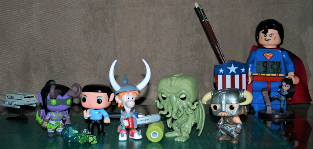 LTR Illidan Stormrage, Spock, Spike, Cthulhu, and Nord, with superfriends in the background