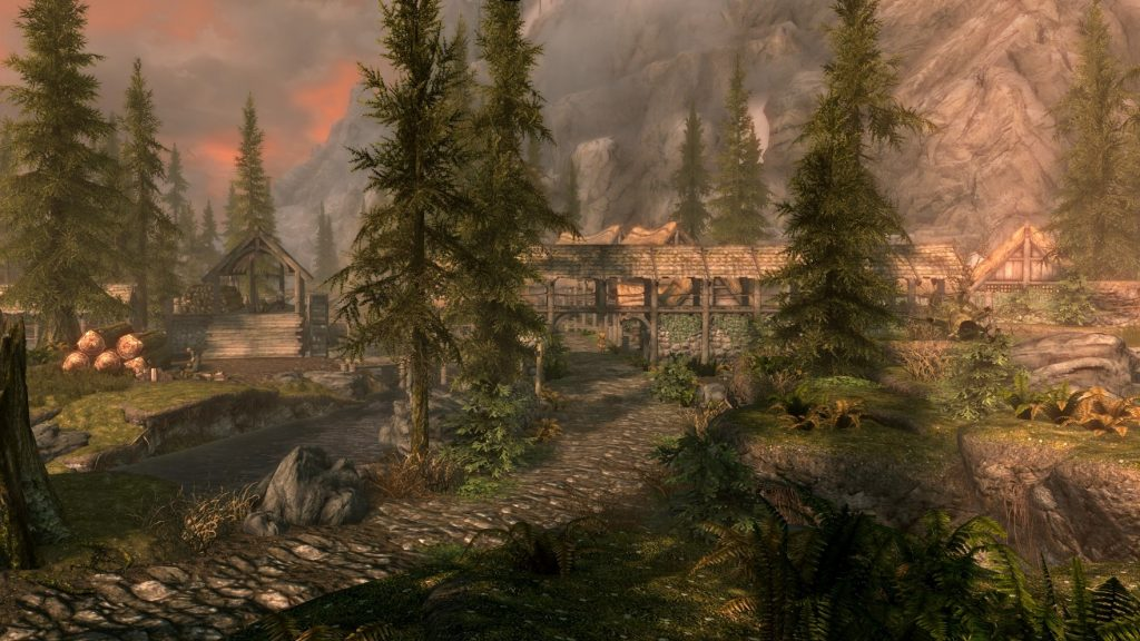 Screengrab of Riverwood from THE ELDER SCROLLS V: SKYRIM. Autumn sunset, with a mill and trees..