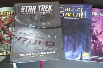 A selection of RPG rule books, including Star Trek Adventures, Call of Cthulhu, Pathfinder, and the Dungeon Master's Guide