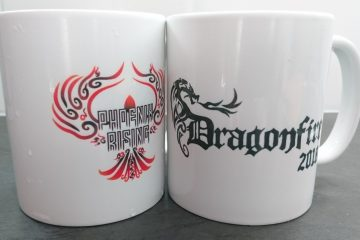 Two coffee mugs with Dragonfire logos